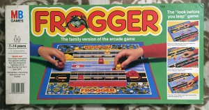 Frogger: The board game lid depicting the board and a game in mid-play.