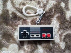A retro Nintendo Entertainment System controller backpack buddy.