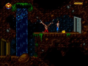 Blackthorne: Kyle Blackthorne stands near a closed metal door. Next to his feet is a collectible item. To the left is a man chained to a wall and a waterfall.