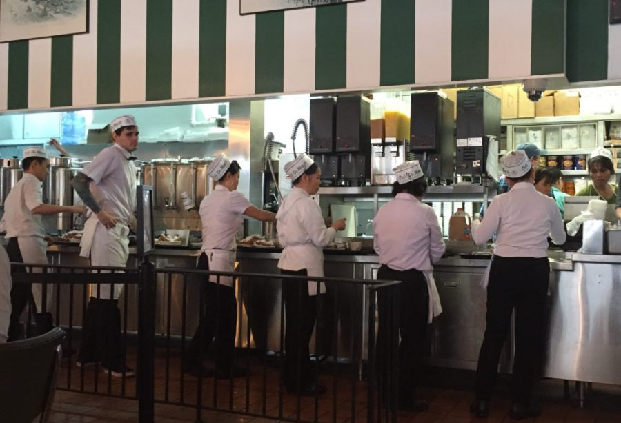 servers at cafe du monde in NOLA