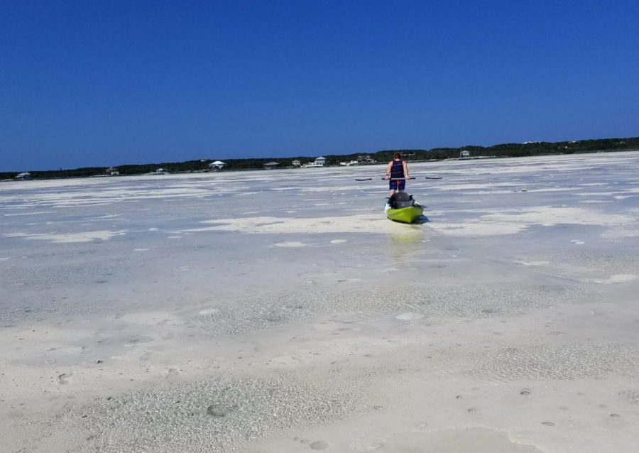 Dragging kayak over the sandbar at bone fish flats exumas