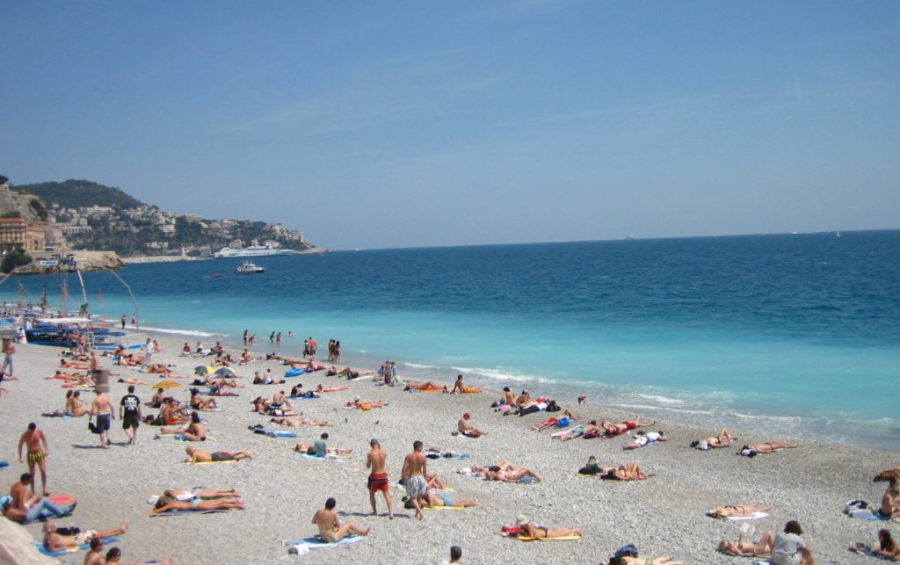 sunny beach scene with bathers in Cannes, France