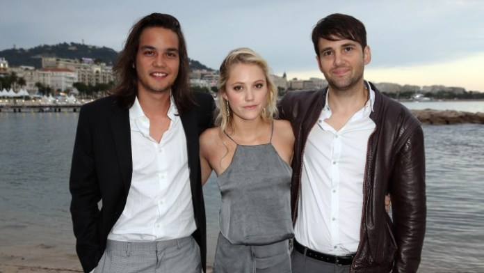 Mitchell with Daniel Zovatto and Maika Monroe at Cannes.