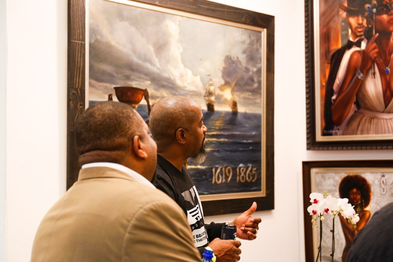 Kevin Williams explains his art to a guest