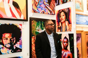 Artist Oscar Lester prepares to answer questions about his art