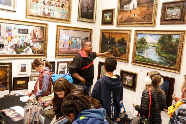 Artist Ted Ellis talks with local students about his art.