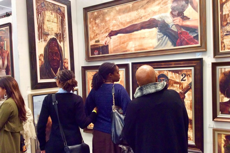 Guests engaging with art at the Kevin Williams exhibit