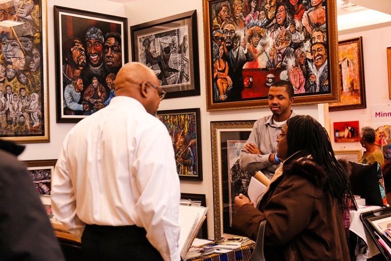 Guests engaging with art and artist Timothy Giles