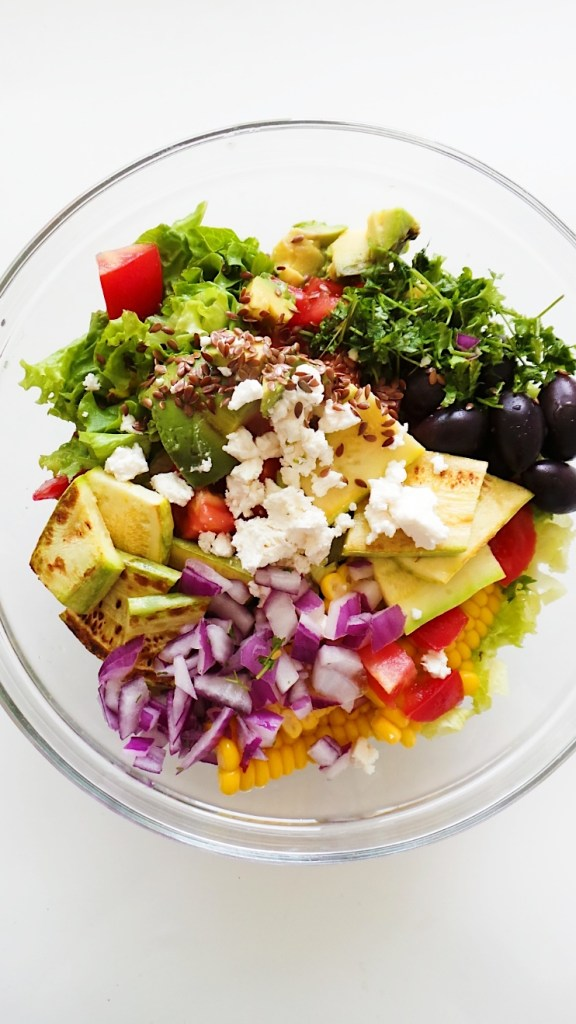 Corn and avocado salad with grilled zucchini, olives, feta cheese and fresh vegetables! This healthy salad is filling, fresh and delicious. The recipe is vegetarian and gluten-free.   Clean Eating Salad Recipes