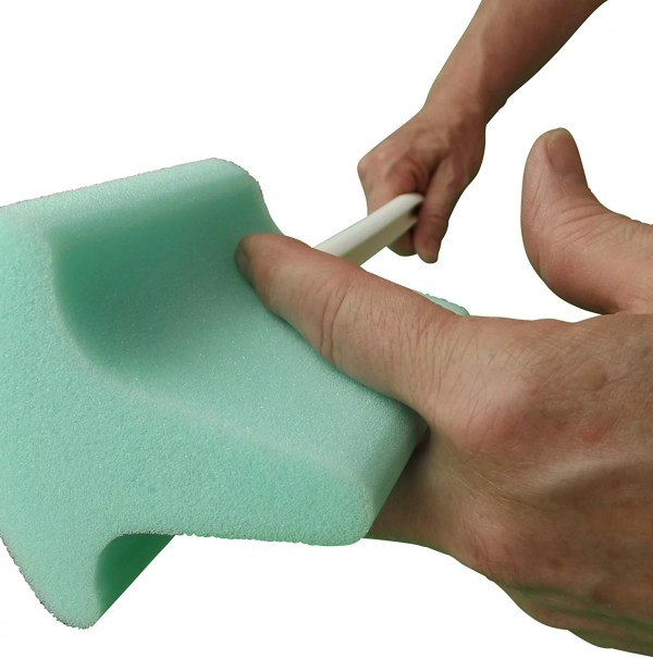 Helping Hand T-shaped Toe-Foot Scrub Sponge. Easily clean in-between toes when you are unable to bend down and reach. Can also be used to dry between toes or apply cream/lotion.