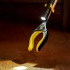 use your stick clip to attach mini torch to find a small object like a hearing aid on the floor