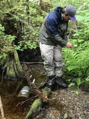 Dylan secures a fish trap in Upper Game Creek