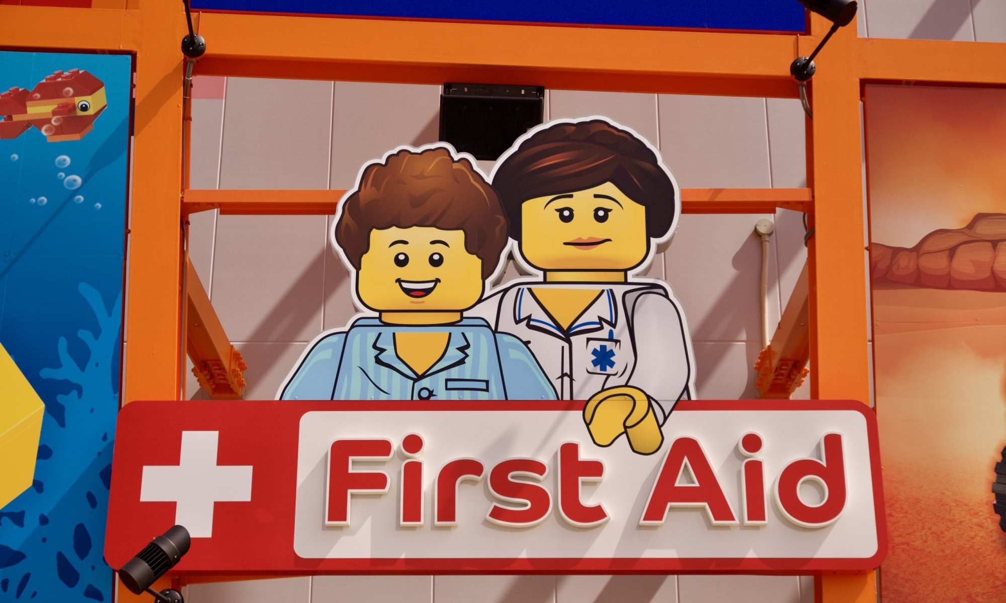 an image of lego characters as doctors with first Aid written