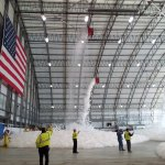 Stalker Electric performing a full discharge test of the foam fire suppression system at the Delta Hangar at Logan International with Massport fire and Delta representatives.