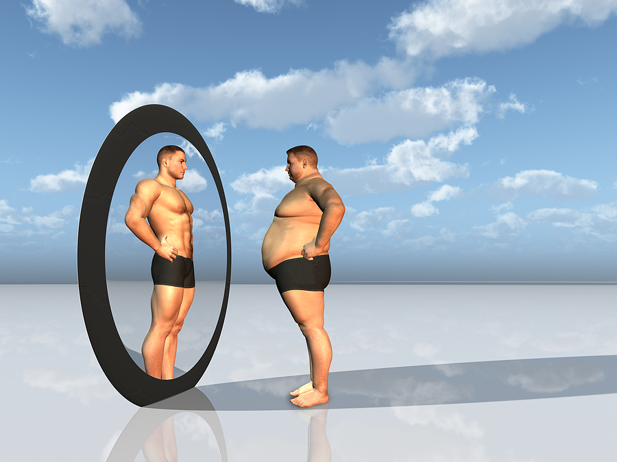 bigstock_Man_sees_other_self_in_mirror_20149157