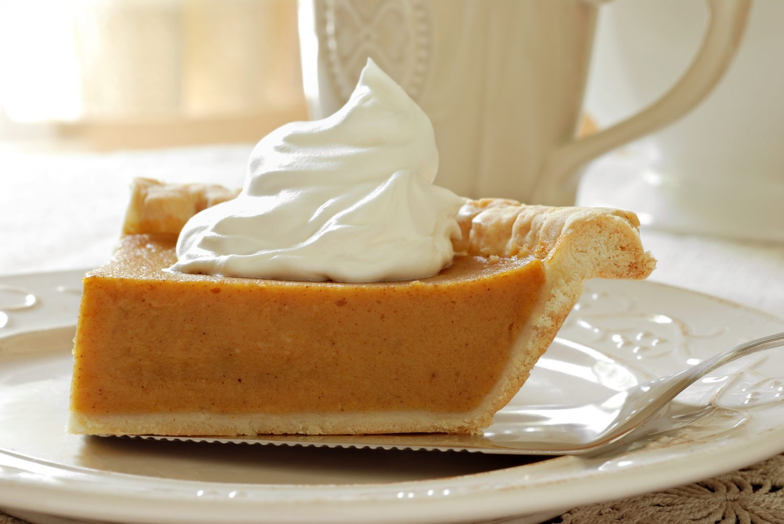 Triple-Infused Pumpkin Pie – Topped with Whipped Cream