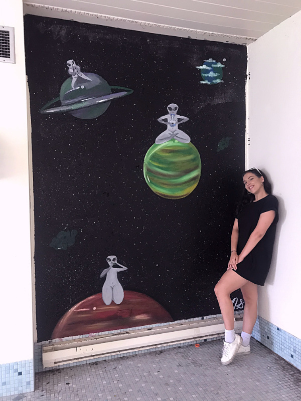 Nikki next to her poolside mural at Bong Mansion