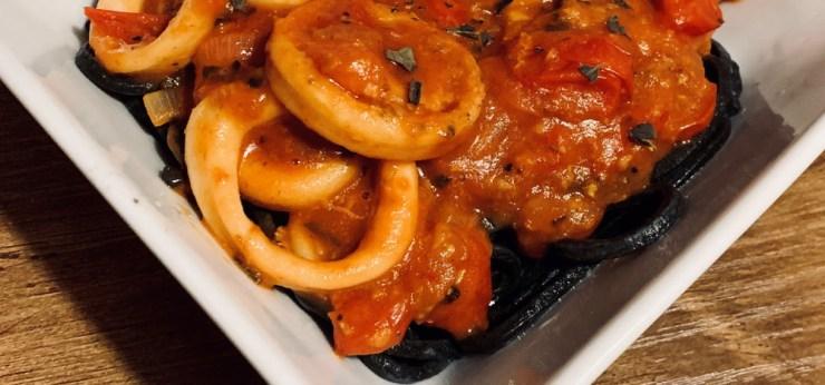 Squid ink spaghetti with calamari