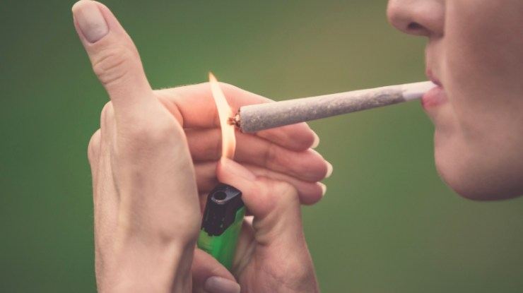 How to smoke a joint. Roll it up. Light it up. Smoke it.