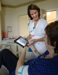 Baptist nurse jessica hall helps patient use my chart bedside tablet also memphis nurses deliver better care through technology rh highgroundnews