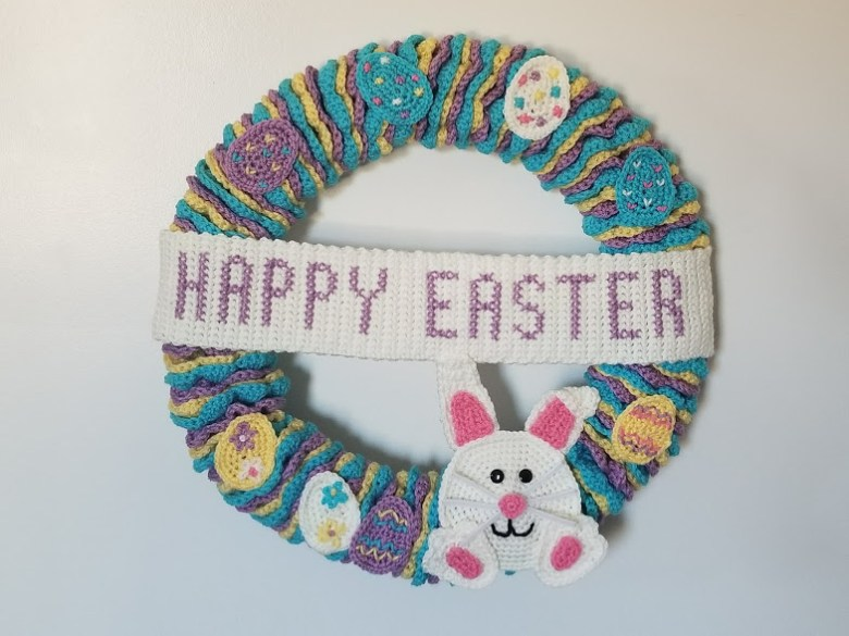 easter wreath with banner and bunny and decorated eggs