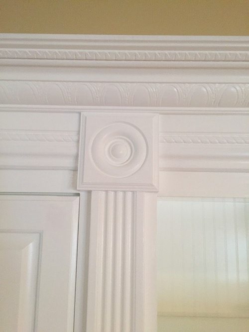 chair rail upside down windsor chairs black august 2018 custom cabinet and bookcase design blog placed on top the second photo shows rosette block at of fluted moulding with base each