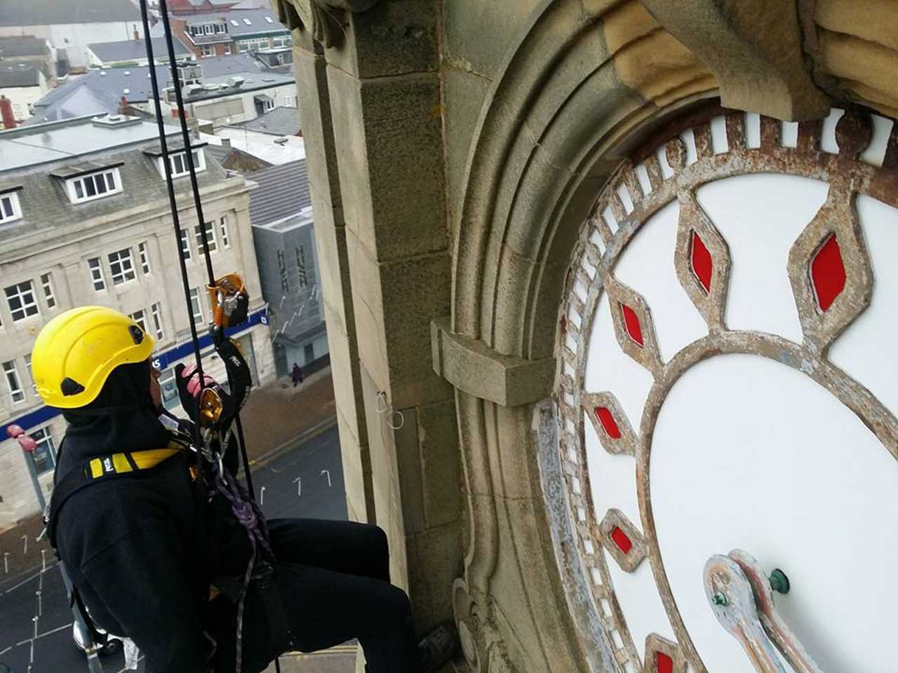 rope access technician provides high level inspection of bird netting on Blackpool Town Hall