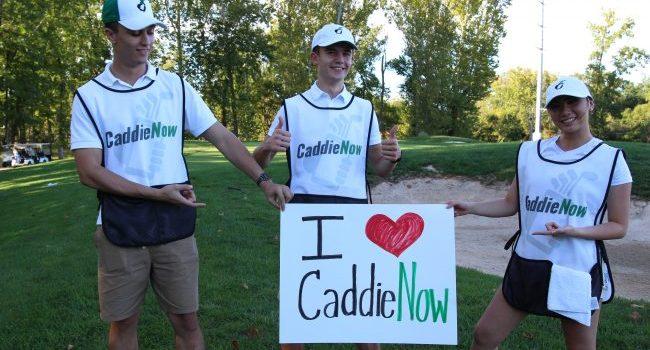 High school golfers caddy