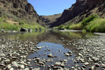A dip into the John Day River after a long day of riding