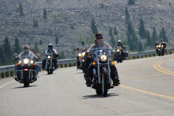 Getting passed by 100+ motorcyclists, escorted by police, at Earthquake Lake on the way to West Yellowstone