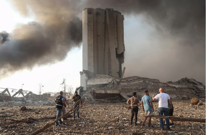 People gather by damaged buildings after a pair of explosions in Beirut on Aug. 4, 2020. (Hasan Shaaban/Bloomberg News)