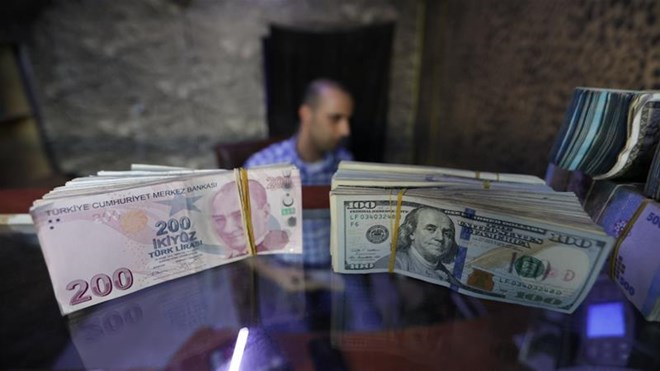 Two years after a devastating currency crisis that brought on a recession and spurred an exodus of foreign investment, the lira was close to halving in value from the beginning of 2018 [File: Khalil Ashawi/Reuters]