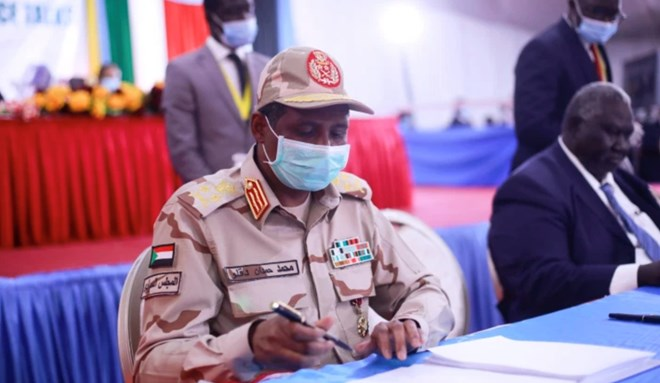 Lieutenant General Mohamed Hamdan Dagalo signed the document on behalf of the Sudanese government [Akuot Chol/AFP]