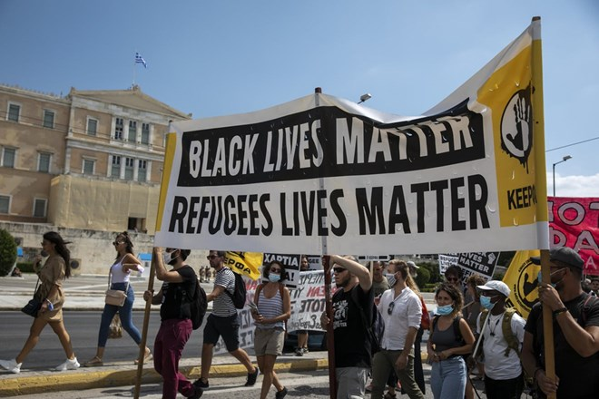 Protesters march in front of the parliament during a rally in support of the migrants on the island of Lesbos, in Athens, Saturday, Sep. 12, 2020. Thousands of asylum-seekers spent a fourth night sleeping in the open on the Greek island of Lesbos, after successive fires destroyed the notoriously overcrowded Moria camp during a coronavirus lockdown.(AP Photo/Yorgos Karahalis)