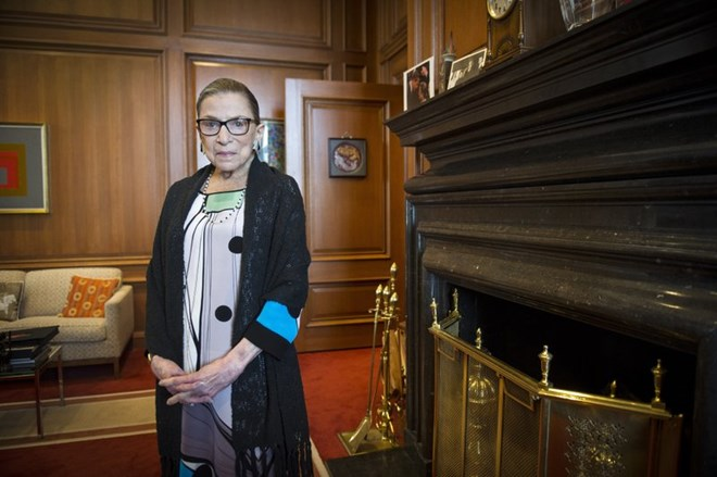 In this July 31, 2014, file photo, Associate Justice Ruth Bader Ginsburg is seen in her chambers in at the Supreme Court in Washington. The Supreme Court says Ginsburg has died of metastatic pancreatic cancer at age 87. (AP Photo/Cliff Owen, File)