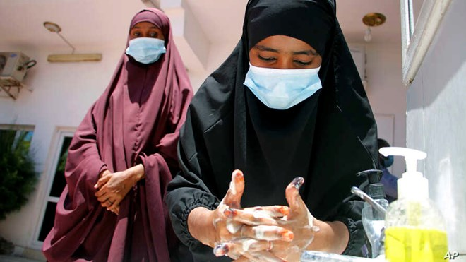Somali females wash their hands during coronavirus awareness training conducted by local paramedics and doctors in Mogadishu, March 19, 2020. Classes in the country were shut in March to try to halt the spread of the coronavirus.