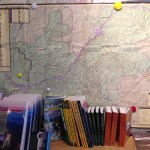 Hiking books and wall map at NOC