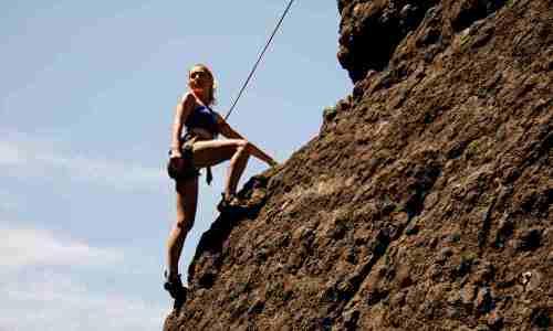 Scrambling girl in mountains