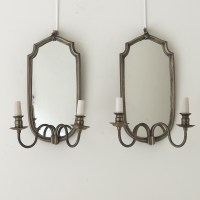 SHIELD SHAPED MIRRORED SCONCES in Lighting