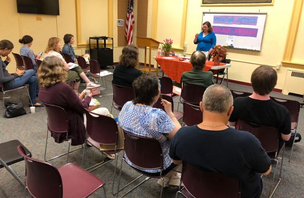Hillary DePiano giving a writing workshop at The Nutley Public Library