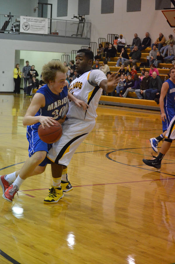 Grif Case draws a foul on Bennington?s BJ Glanton in the second quarter Friday night. Case contributed 10 points in Marion?s 46-37 win over the Bulldogs.