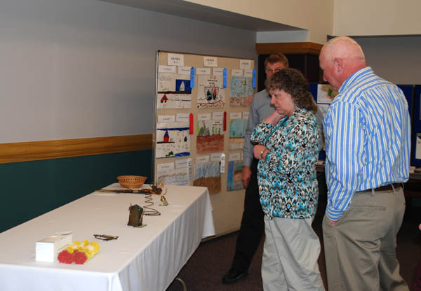 Participants at the annual meeting review the exhibits and posters on display.
