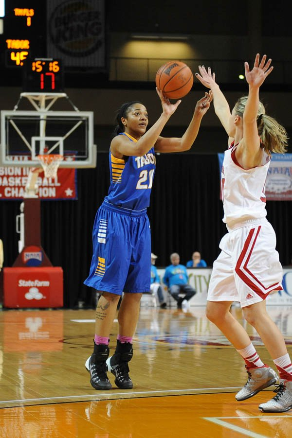 Tonisha Dean shoots for three during the second half of Tabor?s first-round contest against Northwestern in the 2014 NAIA Division II Women?s Basketball National Championship. Dean led Tabor with 14 points in the Bluejays? 63-62 loss.