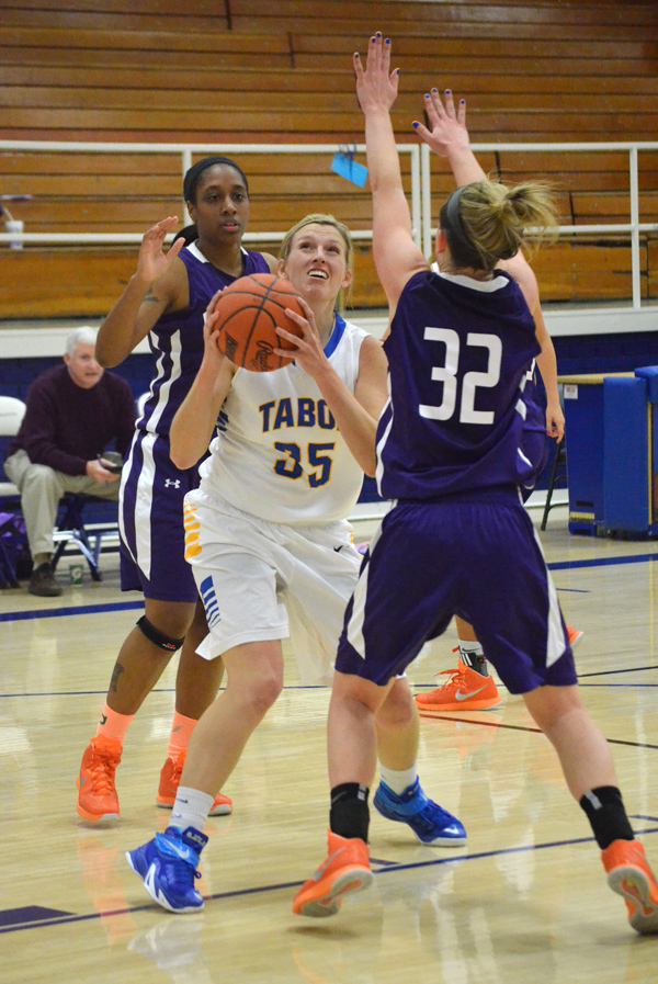 Taylor Janzen eyes the basket during the first half of Tabor?s home game against Missouri Valley Tuesday. Janzen contributed nine points in Tabor?s 70-66 victory. The Bluejays defeated the Vikings a second time Saturday, 77-64. Janae Rempel / Free Press