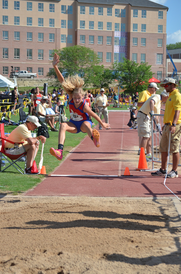 Marion?s Marissa Jacobson shows the form that won her a gold medal in triple jump at the state track meet. She competed in four events, including the gold-medal-winning 4x400 relay. Free Press file photo