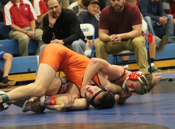 Ezra Darnall wrestles Herington?s Theron Miller at 126 pounds. Darnall won by fall and went on to place fourth in the Halstead Invitational tournament. Don Ratzlaff / Free Press