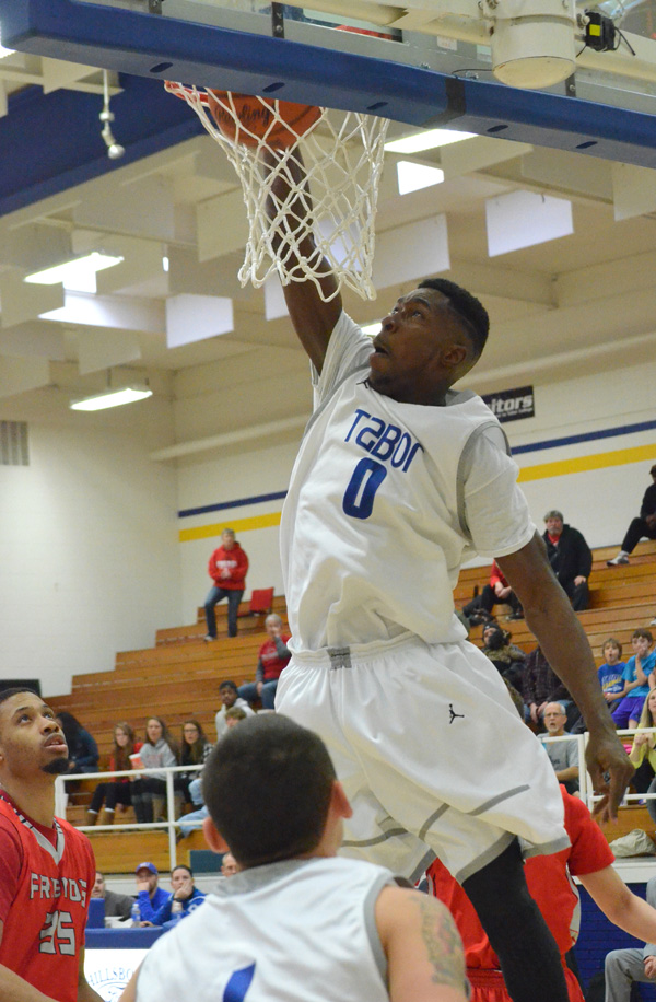 Andrew Thomas dunks the ball to bring Tabor within 54-49 during the second half against Friends. Thomas had a double double with 15 points and 10 rebounds.