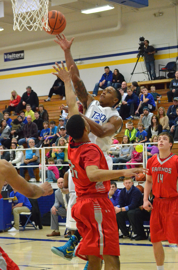 Dewayne Biggs shoots for two during the second half against Friends. Biggs led Tabor with 19 points in the Bluejays? 89-79 loss.