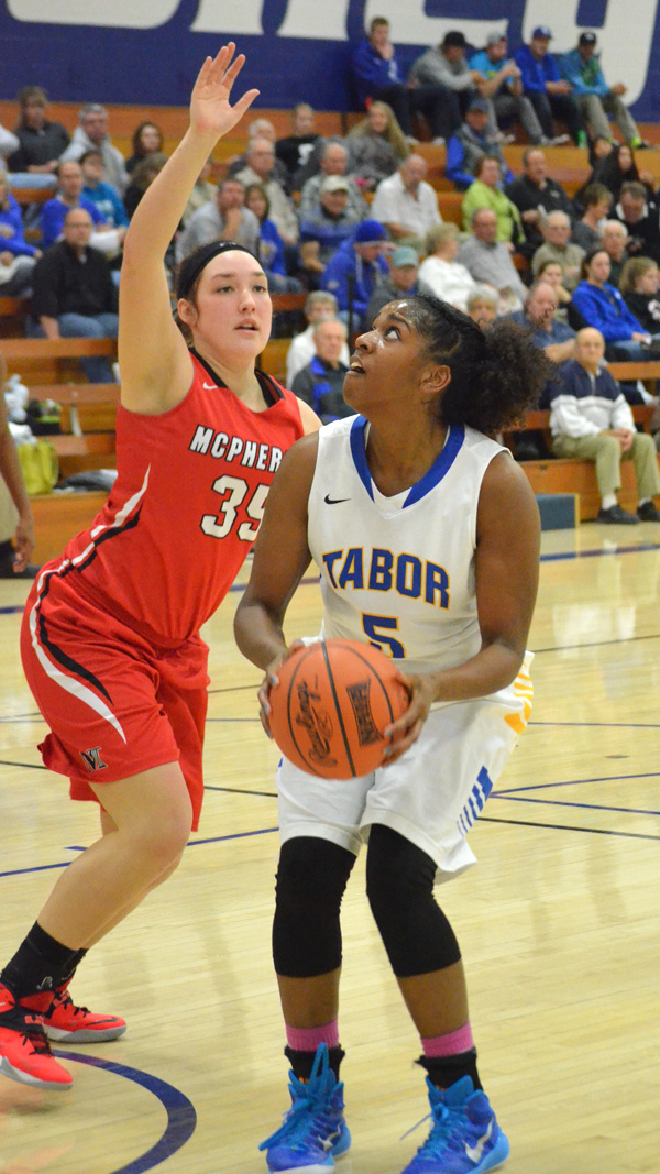 Erin Maxwell scores during the second half to give Tabor a 56-34 lead over McPherson.