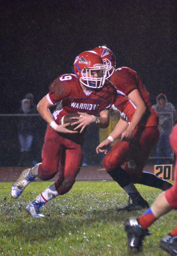 Janae Rempel / Free Press<p>Corbin Wheeler takes the handoff from Jack Schneider and rushes for a 10-yard touchdown to give Marion a 16-8 lead over Mission Valley during the second quarter Friday. Marion concluded its season with a 22-20 victory over the district-champion Vikings.